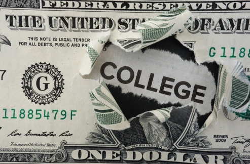 35288872 - paper headline with college text in torn dollar bill